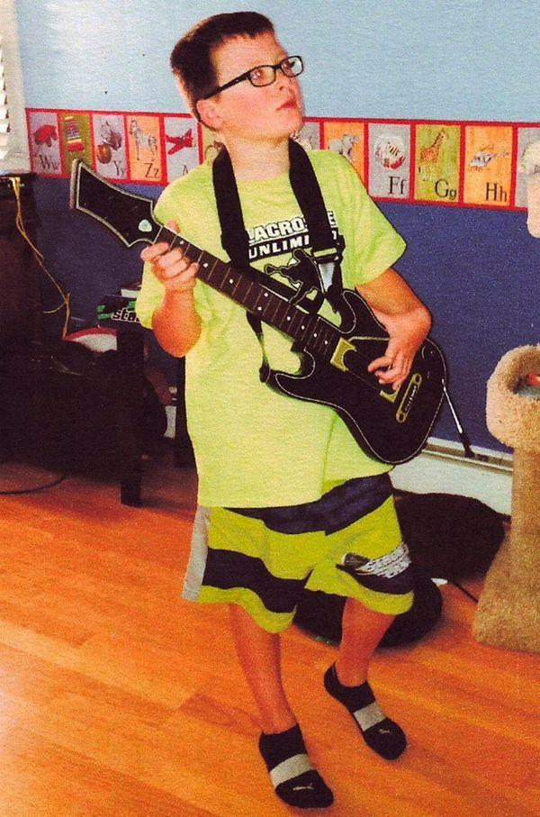 Kidsday reporter Gavin Maron of Oakdale plays Guitar