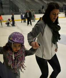 Connie Gonzalez teaches her daughter Julianna how to