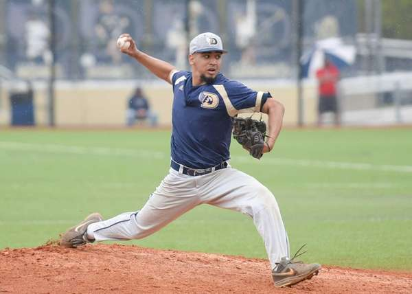 Dowling's Chris Cepeda (1) delivers during the Dowling
