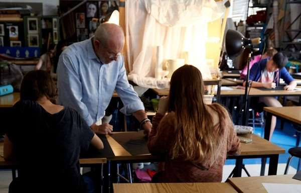 Art teacher Warren Jacobson works with students at