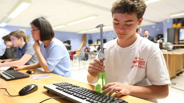 Northport High School ninth-grader Jack Bivona, 14, works