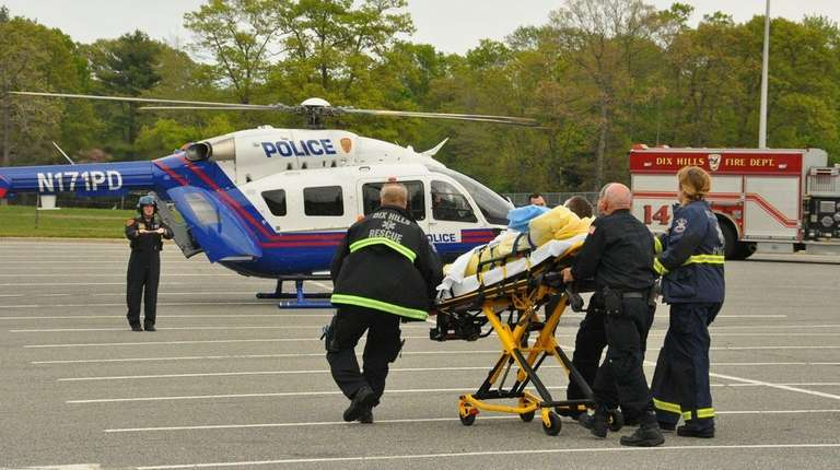 Emergency medical personnel from the Dix Hills Fire