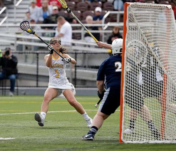 Adelphi attacker Jacqueline Jahelka (5) winds up for