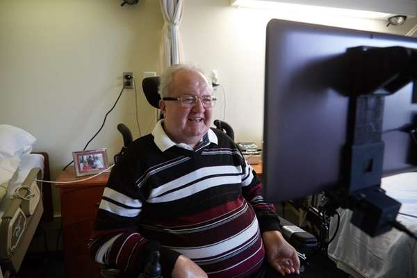 John Cincar, who cannot use his limbs, demonstrates