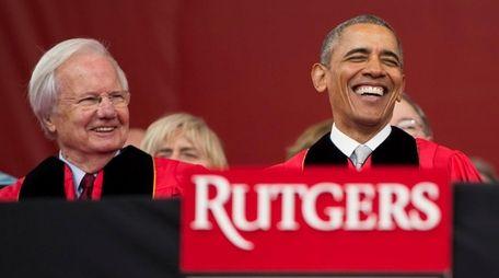 President Barack Obama shares a laugh with former