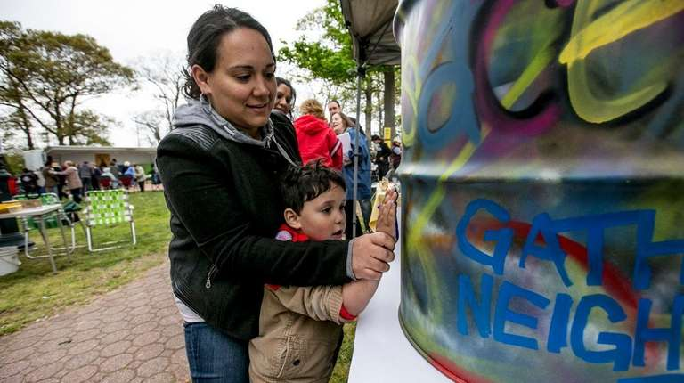 Feride Castillo, 32, of Brentwood, helps her 3-year-old