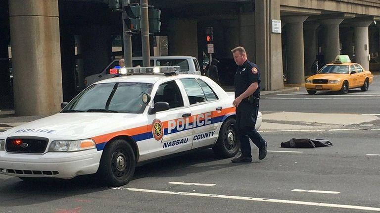 Nassau County police respond to a crash that