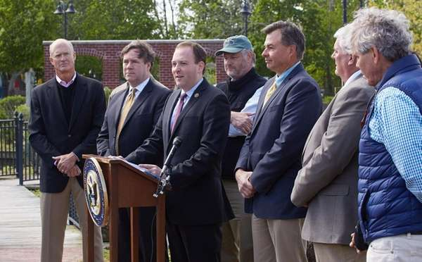 Rep. Lee Zeldin, center, with local officials and