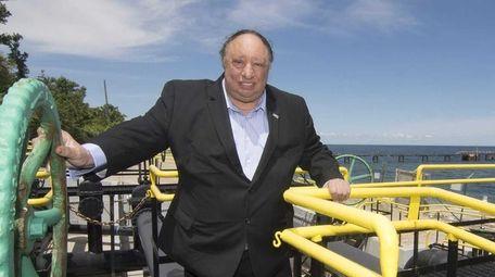 John Catsimatidis stands on his beach pump manifold