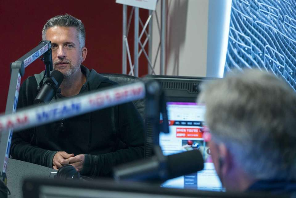 Guest host Bill Simmons, left, talks with Mike