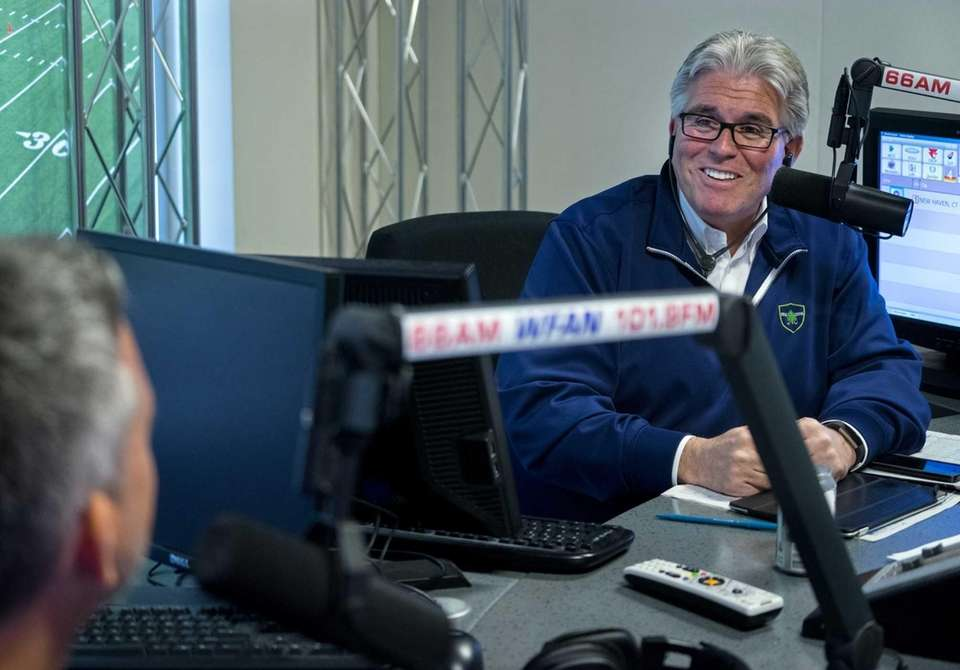 Mike Francesa, right, talks with guest host Bill