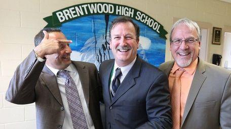Brentwood High School Principal Richard Loeschner, center, is