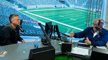 Mike Francesa engages guest host Bill Simmons, left,