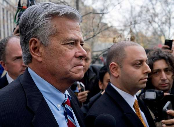 Dean and Adam Skelos walk from the federal
