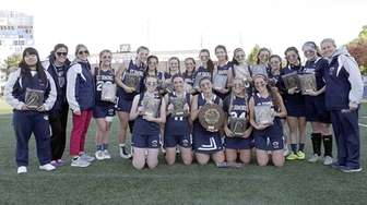 The St. Dominic girls lacrosse team celebrates its