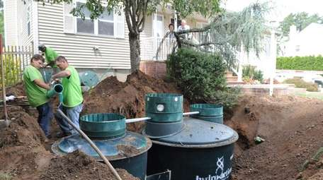 An alternative septic system is installed in front