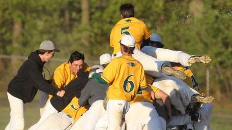 Ward Melville celebrates their extra-inning win over Half