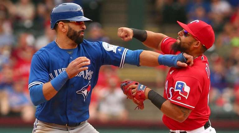 Toronto Blue Jays Jose Bautista (19) gets hit