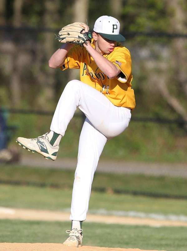 Ward Melville's Matt Hudzik (17) pitches in the