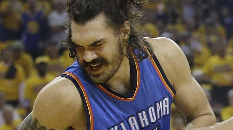 Oklahoma City Thunder center Steven Adams, left, is