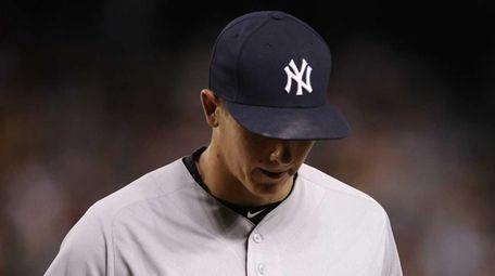 New York Yankees pitcher Chad Green walks back
