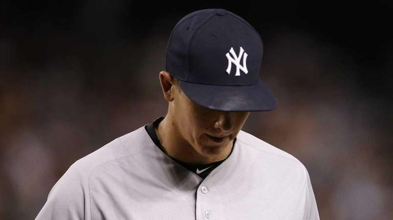 New York Yankees pitcher Chad Green walks back
