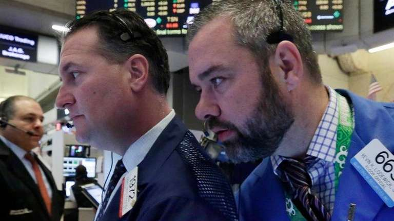 Traders Jonathan Corpina, left, and Kevin Lodewick work