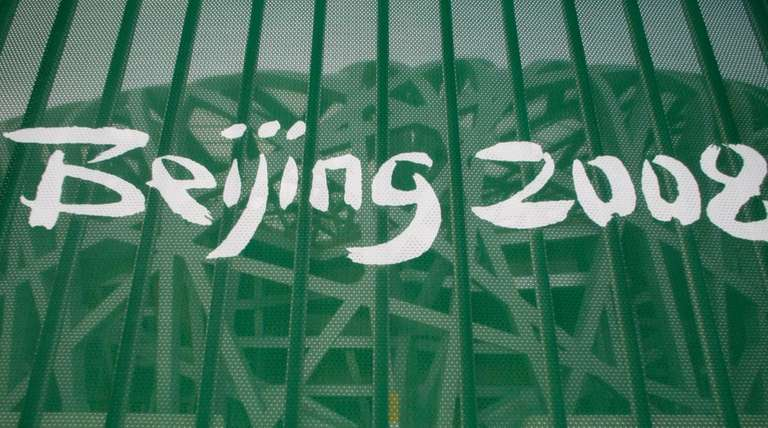 A protective fence with a Beijing 2008 logo