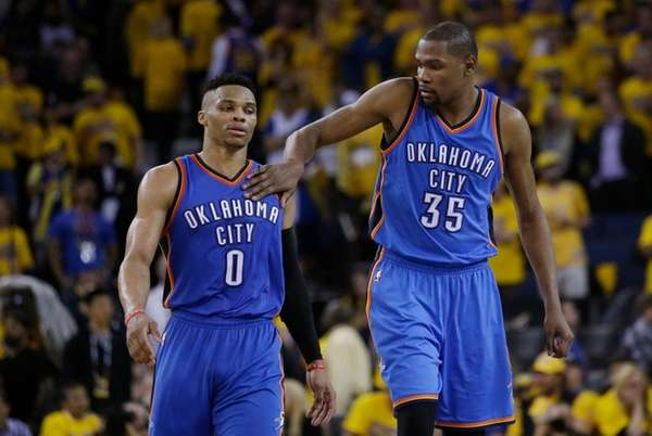 Oklahoma City Thunder's Kevin Durant, right, pats teammate