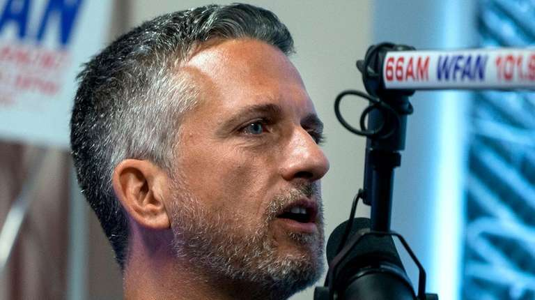 Sports analyst guest host Bill Simmons engages Mike