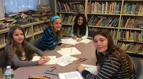 Kidsday reporters working in their writing club. From