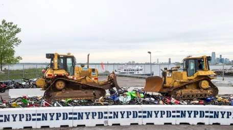 The NYPD crushed dozens of seized dirt bikes
