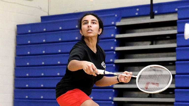 Half Hollow Hills' Irene Antony with the backhand