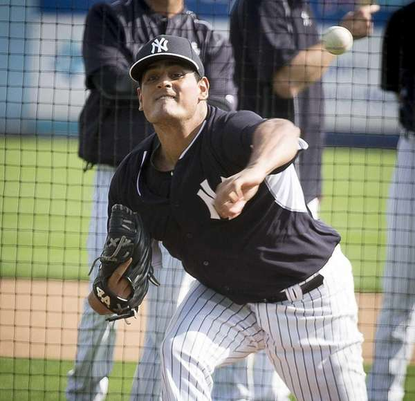 New York Yankees' pitcher James Pazos throwing from