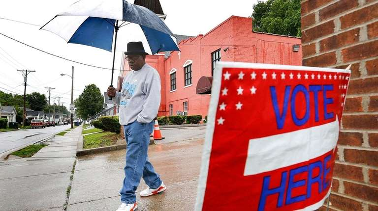 Ricky Richardson leaves his polling place after voting