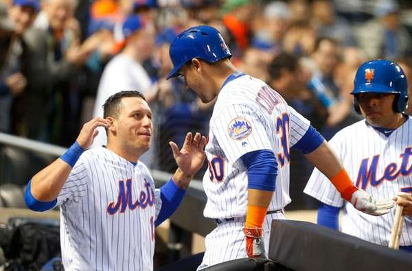 Michael Conforto is greeted at the Mets dugout