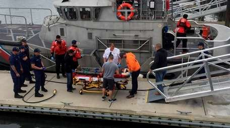 Coast Guard Station Jones Beach crew members transport