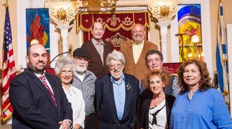 Rabbi Daniel Geffen, left, and congregants stand inside