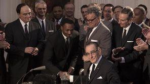 Bradley Whitford, left, looks on as Anthony Mackie