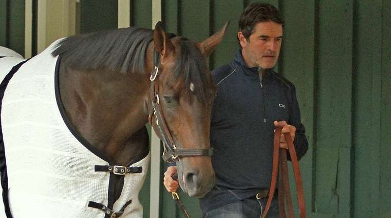 Trainer Keith Desormeaux walks Preakness Stakes hopeful Exaggerator