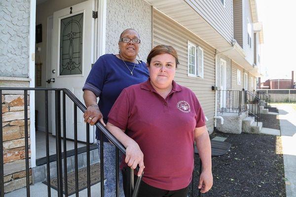 U.S. Army veterans and neighbors, Alana Downey, right,