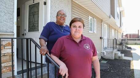 U.S. Army veterans and neighbors, Alana Downey, right,