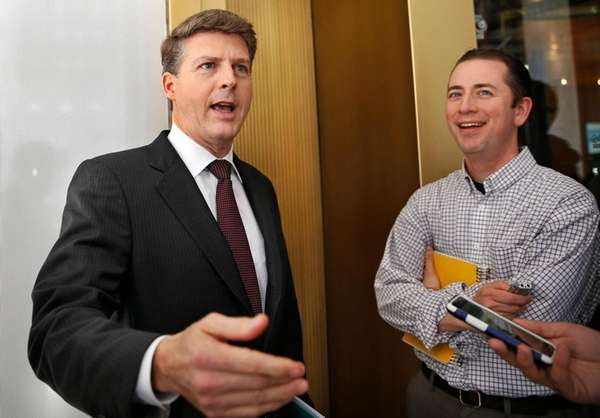 New York Yankees owner Hal Steinbrenner, left, talks