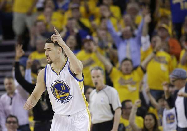 Golden State Warriors guard Klay Thompson (11) reacts