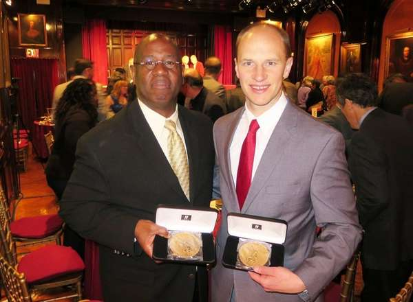 Newsday staffers J. Conrad Williams, left, and Jim