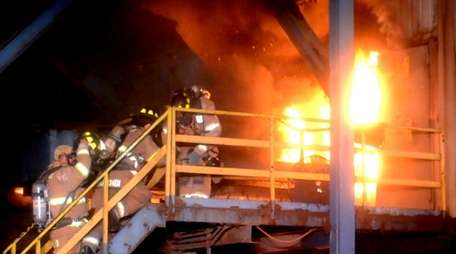 Firefighters battle a blaze at Gershow Recycling in