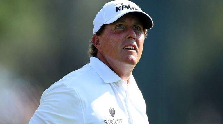 Phil Mickelson plays a shot on the 14th