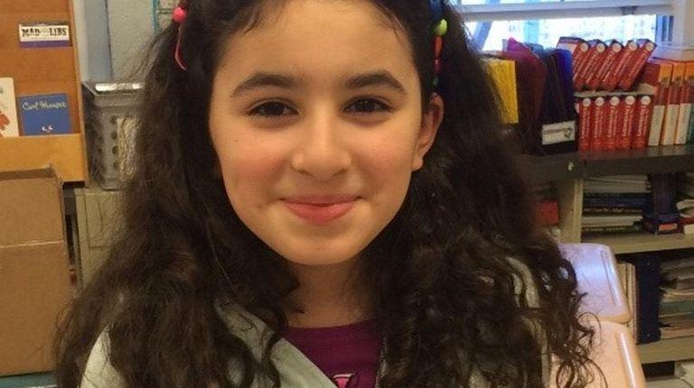 Kidsday reporter Andrea Napoles wears a headband she