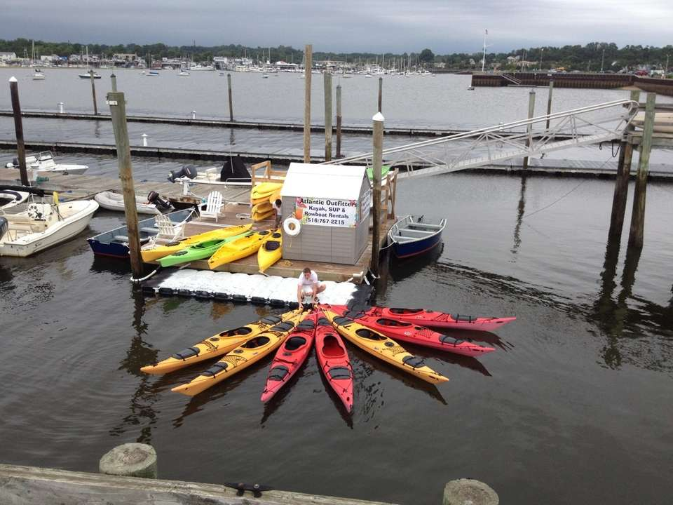 Atlantic Outfitters in Port Washington rests paddleboards, rowboats,