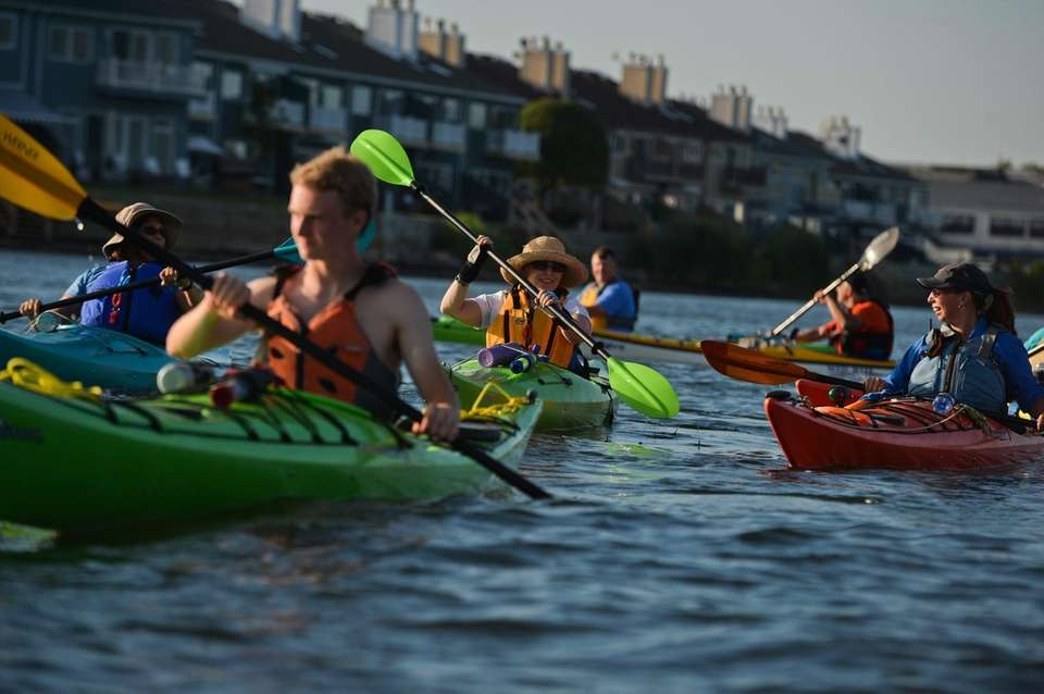Rochelle Roberts, center, of Plainview, among other kayakers